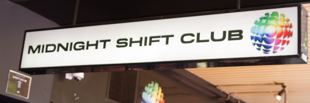 Midnight Shift Bar Under Awning Signage
